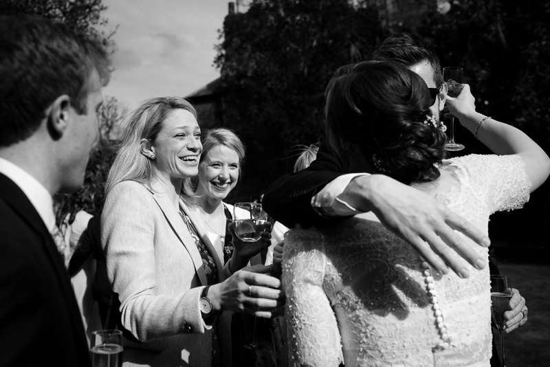 Bride greets guests at Cambridge Cottage