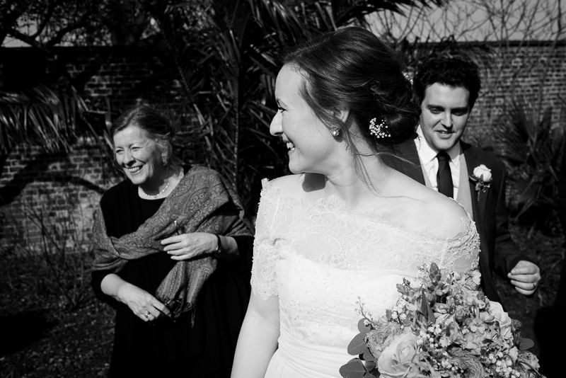 Bride with guests in gardens surrounding Cambridge Cottage