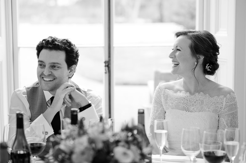 Bride and groom react to speeches at Kew Garden wedding