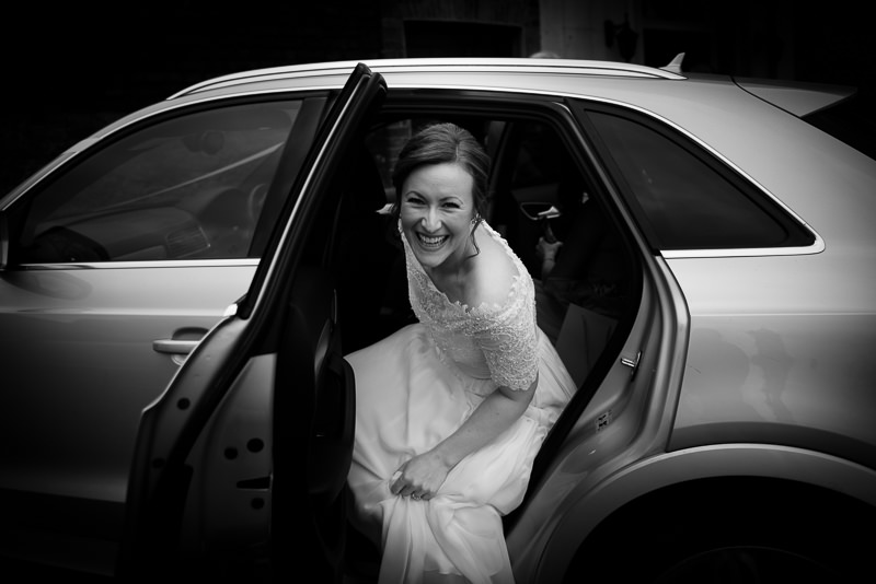Bride arrives for Cambridge Cottage wedding