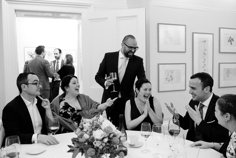 Guests laugh during Cambridge Cottage wedding reception