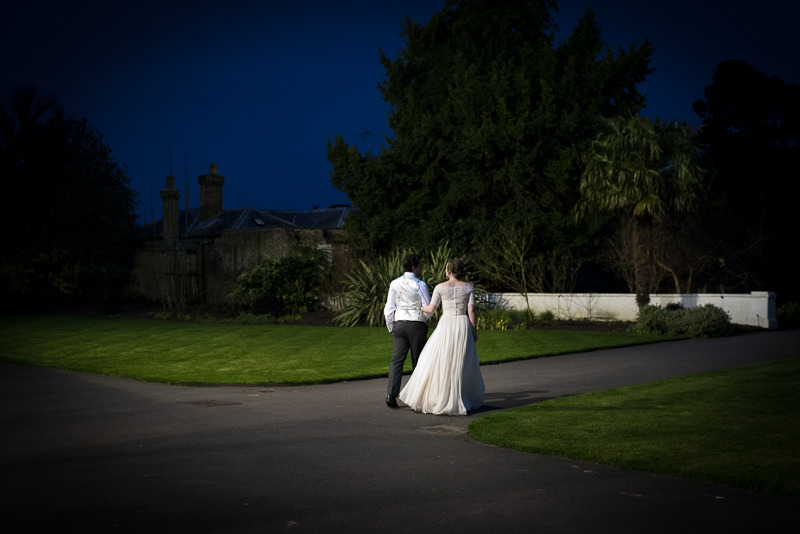 Bride and groom in Kew Gardens at night