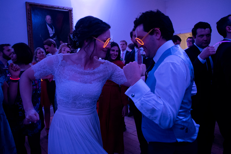 Bride and groom dance with glow bands at Cambridge Cottage