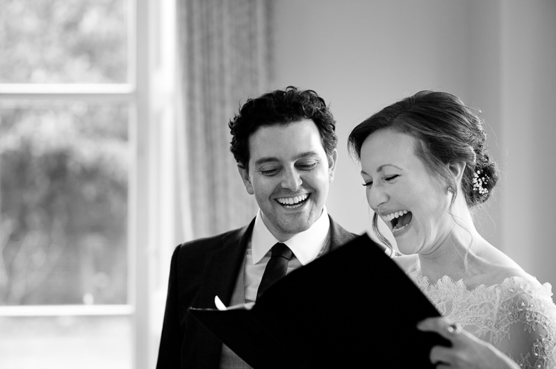 Bride and groom sing at Cambridge Cottage wedding ceremony