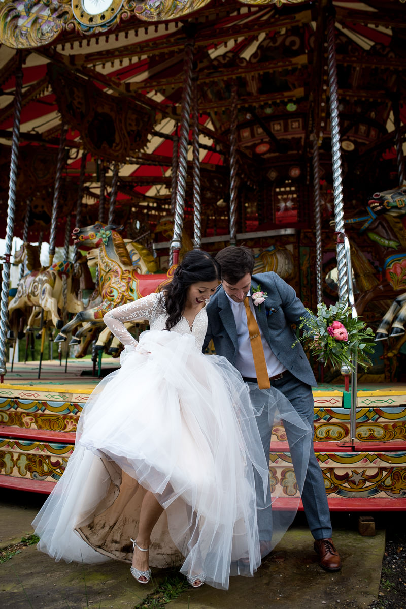 Bride and groom on merry go round at Fawley Hill