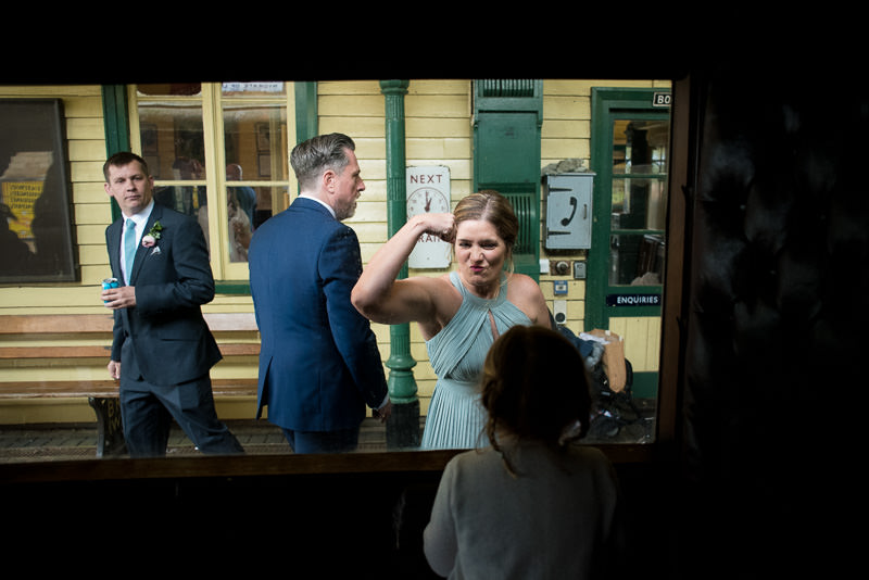 Bridesmaids plays with flower girl on train at Fawley Hill wedding