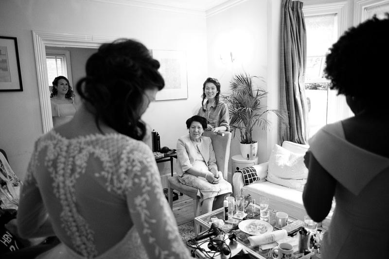 Bride shows Mum her dress