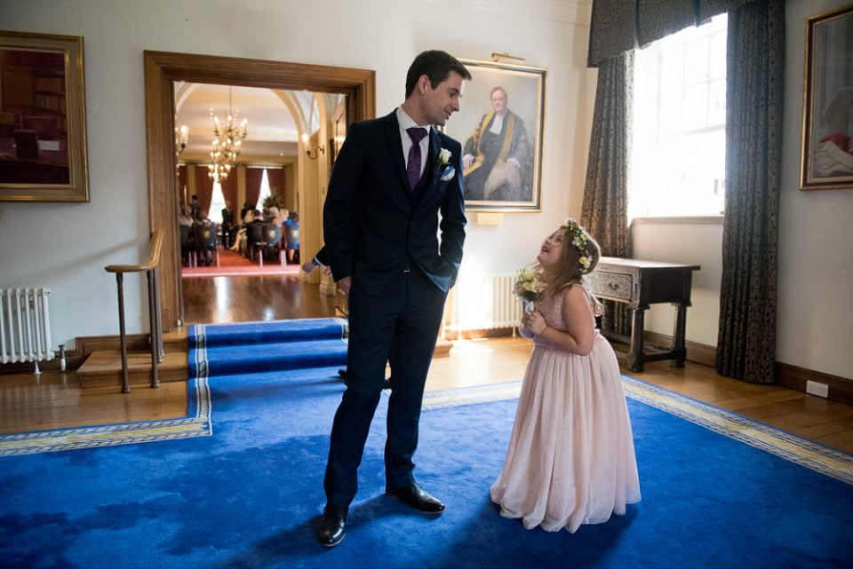 Natural Gray's Inn Wedding Photography of groom and flower girl outside ceremony room