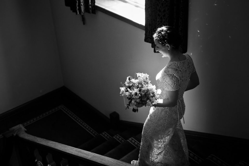 Black and white Gray's Inn Wedding Photography of bride walking down the stairs