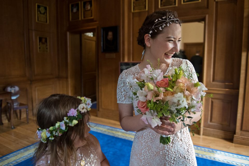 Bride greets guests at Gray's Inn wedding