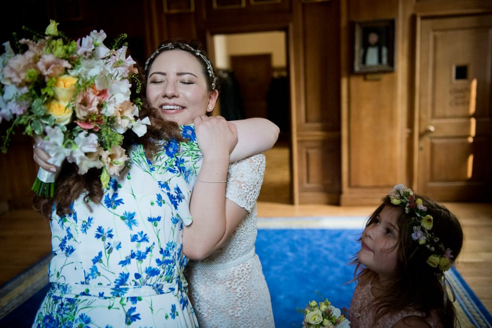 Bride hugs guests at Gray's Inn wedding