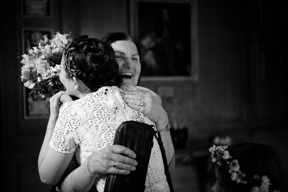 Black and white Gray's Inn wedding photography of bride hugging mother