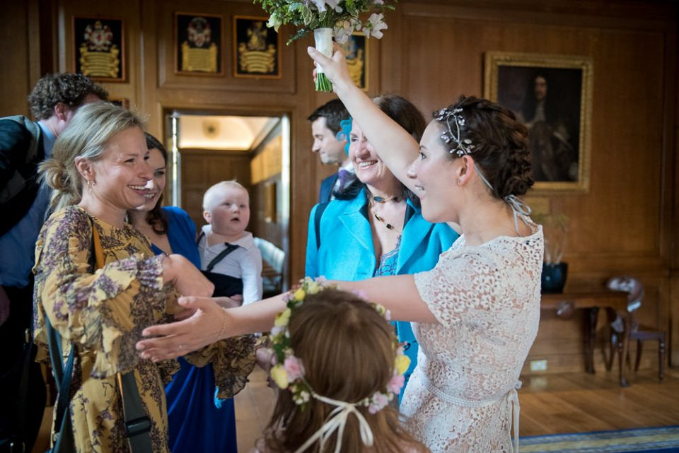Bride welcomes guests at the Honourable Society of Gray's Inn
