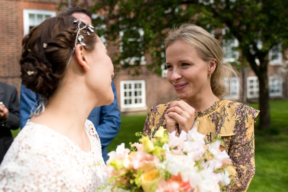 Bride greets friend at the Honourable Society of Gray's Inn