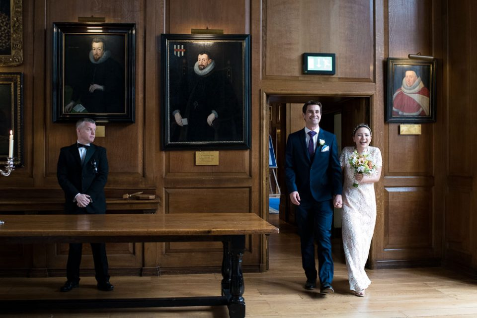 Bride and groom enter the hall at Gray's Inn wedding