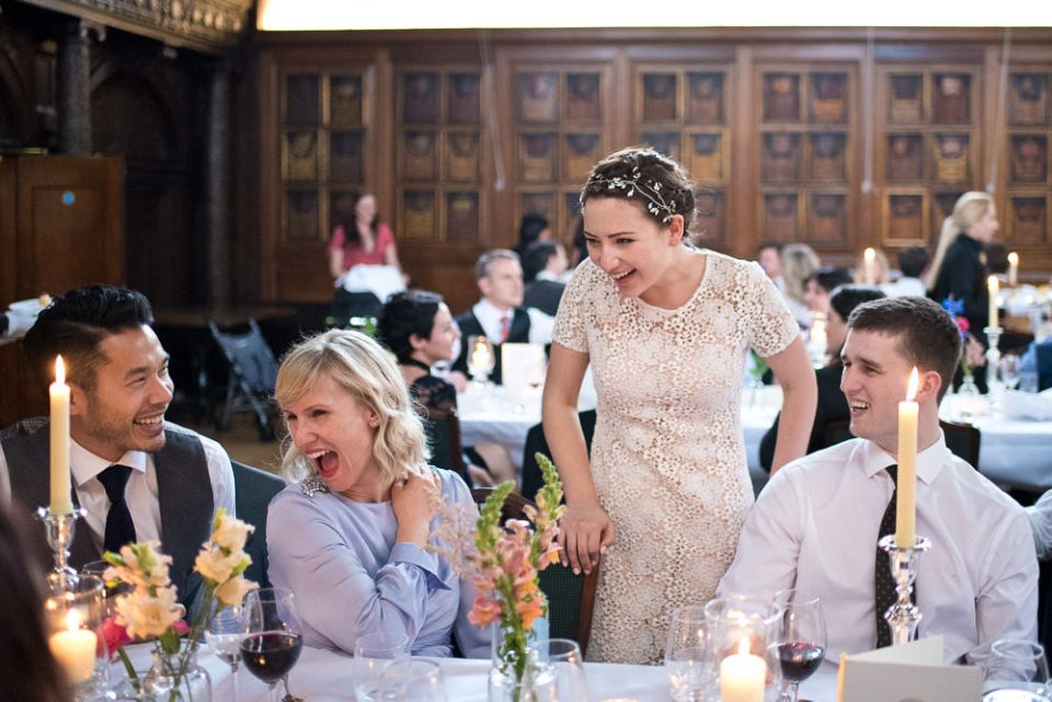 Bride laughs with guests at Gray's Inn wedding reception