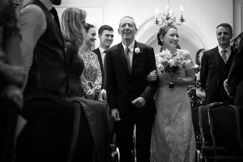 Bride and Dad walk down the aisle at Gray's Inn wedding ceremony