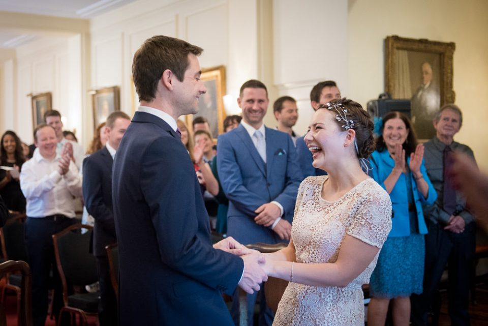 Bride and groom laugh during Gray's Inn wedding ceremony