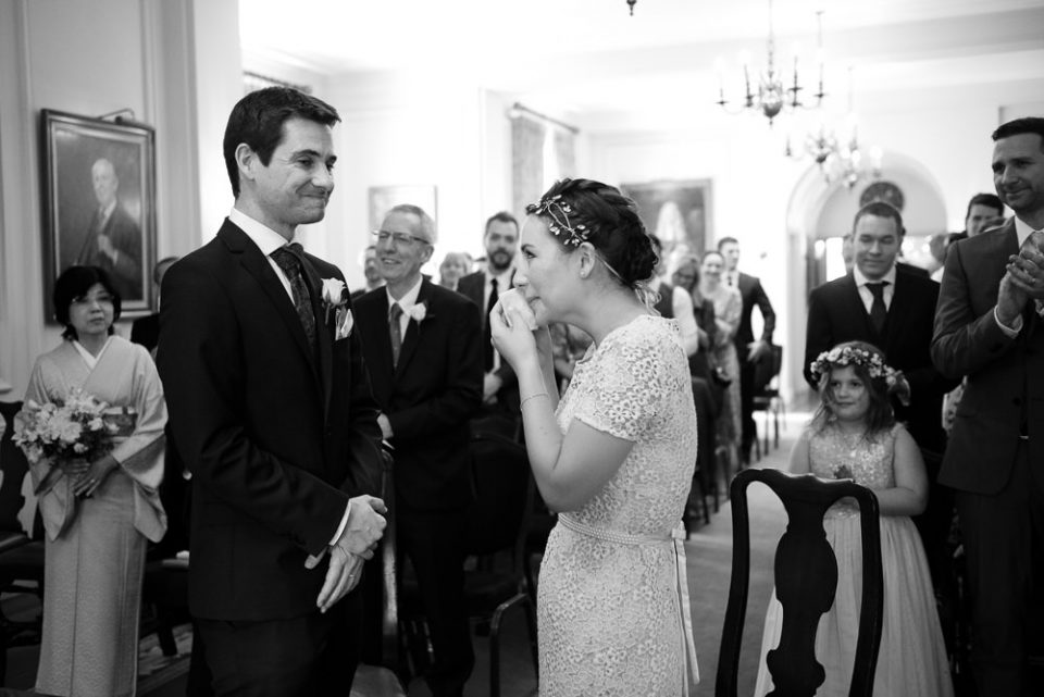Bride is emotional during wedding ceremony at Gray's Inn