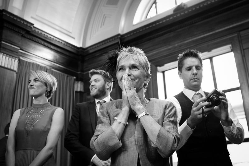 Documentary Wedding Photograph of Mum reaction to daughter walking down the aisle