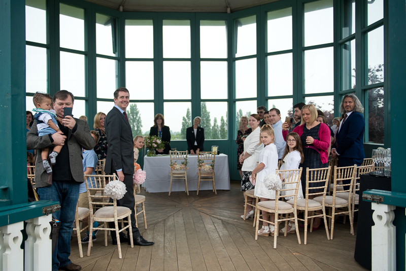 Guests awaiting bride and groom at Horniman bandstand