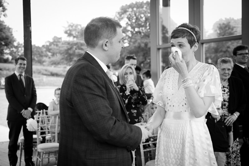 Bride cries during wedding ceremony at Horniman bandstand
