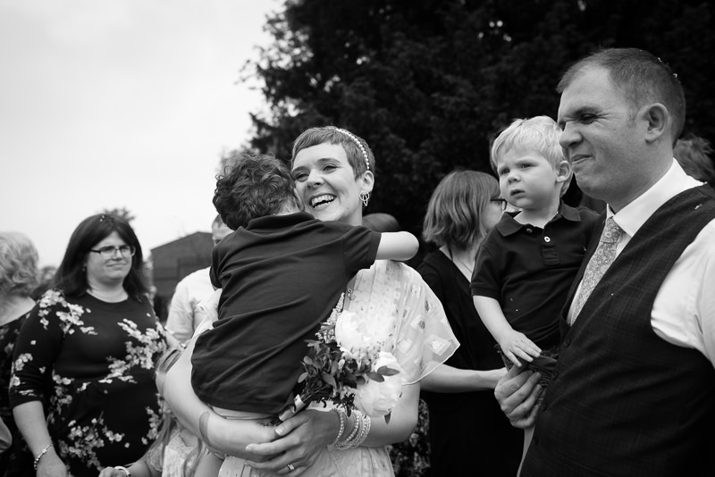 Bride hugs her son at Horniman museum wedding
