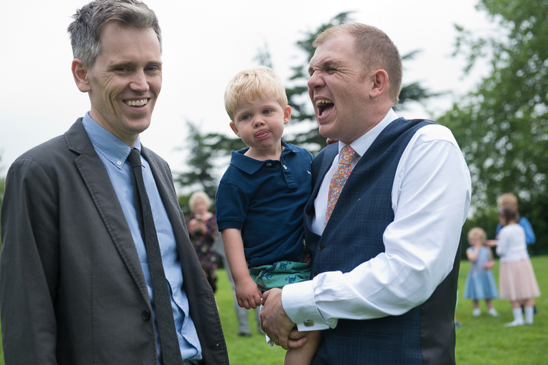 Groom with guests and son at Horniman museum wedding