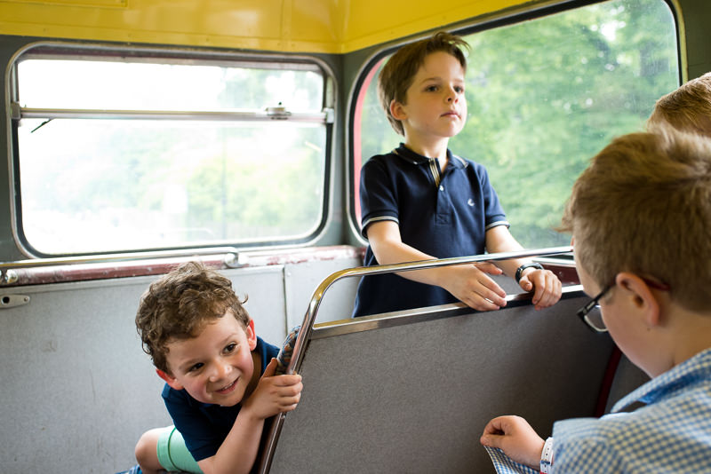 Children in routemaster bus on way to wedding