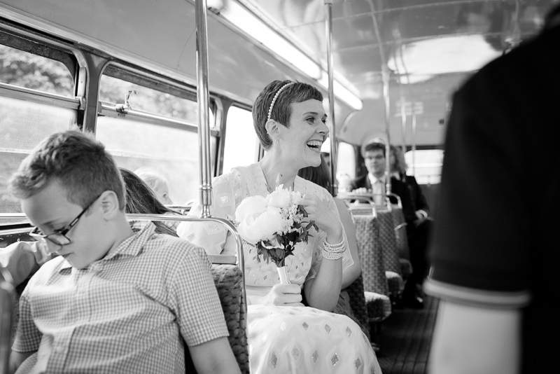 Black and white photograph of bride on Routemaster bus