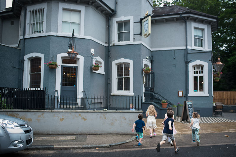 Kids run inside pub for Dulwich pub wedding