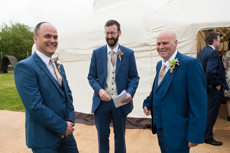 Groom outside yurt before humanist cereomony