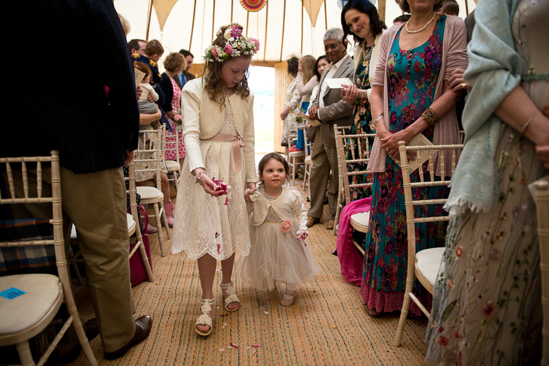 Flower girls entering yurt at North Hill Farm