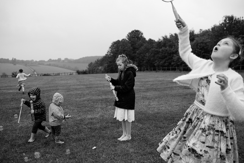 Children playing in field at North Hill Farm wedding