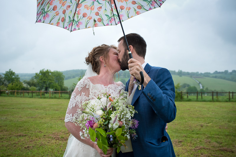 Bride and groom portraits on a rainy day at North Hill Farm