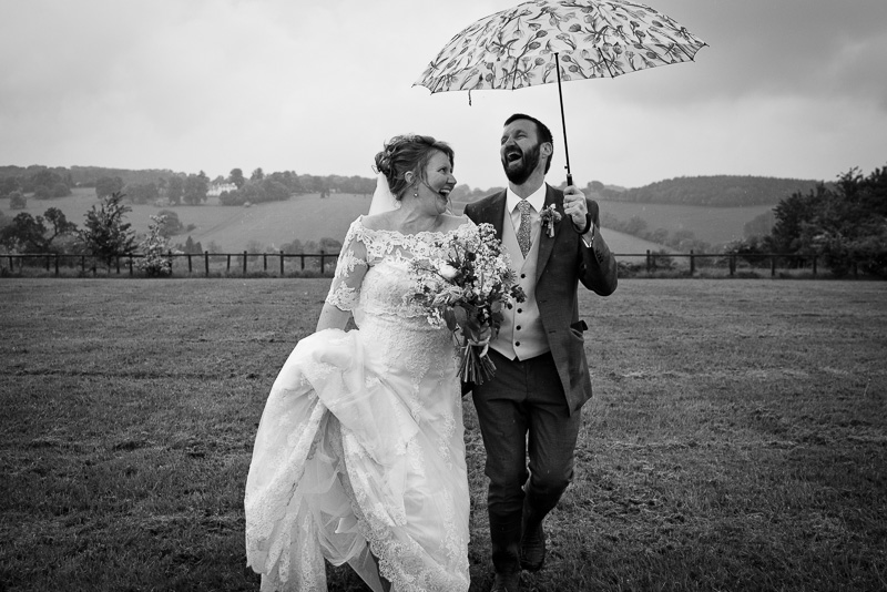Bride and groom at rainy North Hill Farm wedding