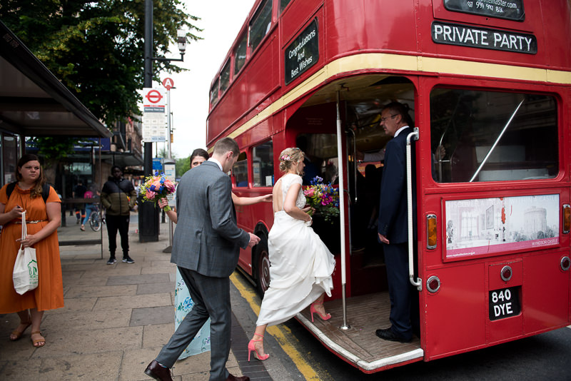 Bride and groom get on Routemaster bus for Hackney Pub wedding