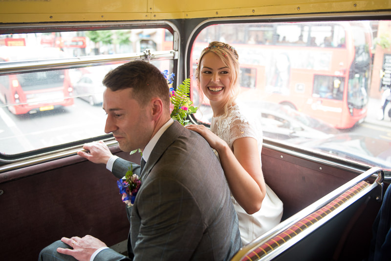 Bride and groom on Routemaster bus in Hackney