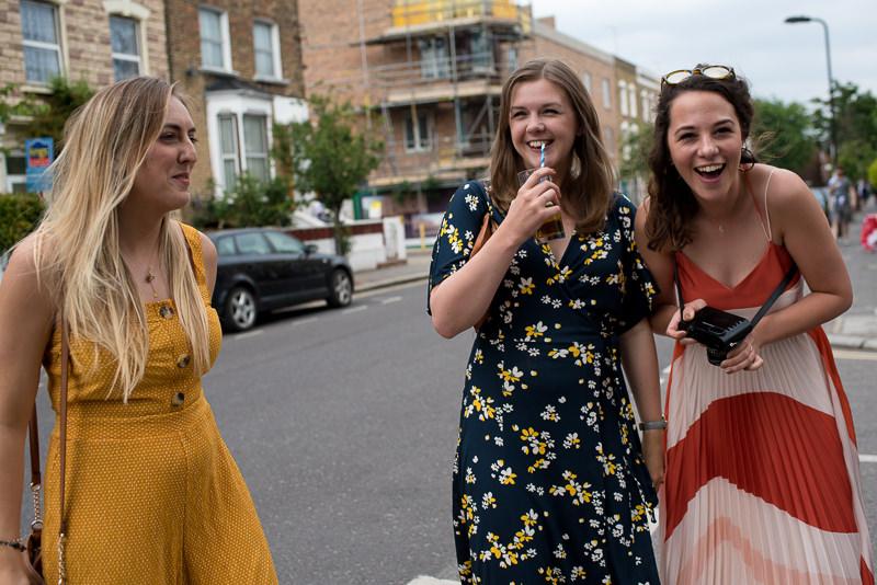 Guest mingle outside Hackney Pub