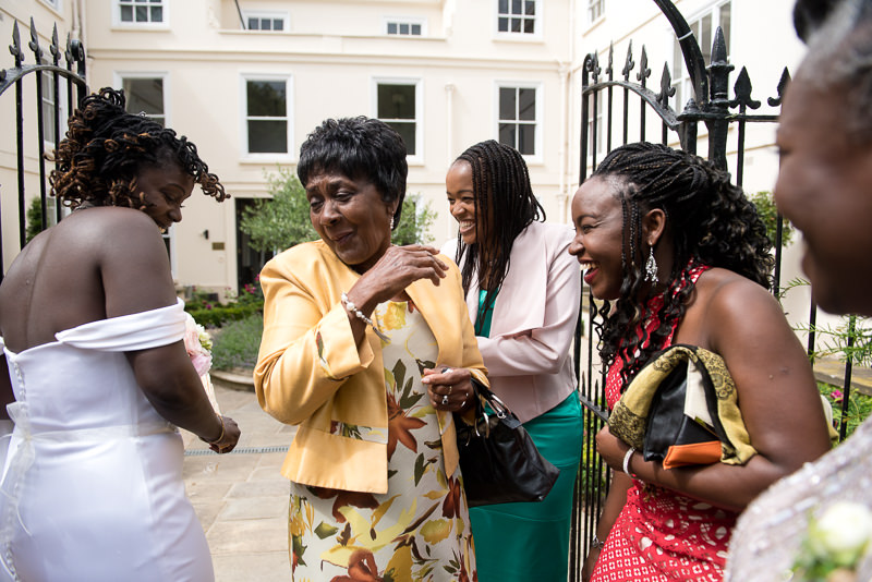 Black bride mingles with guests at Morden Hall wedding