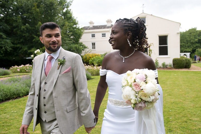 Mixed race couple portraits of bride and groom at Morden Hall
