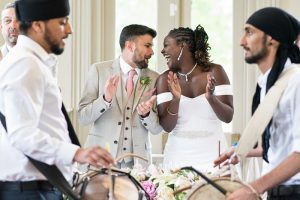 Indian drummers and wedding couple at Morden Hall wedding