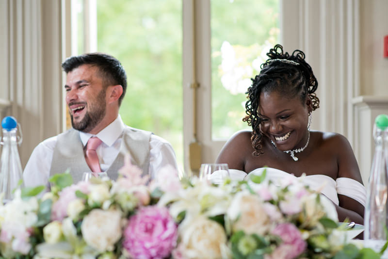 Bride and groom enjoy wedding breakfast at Morden Hall