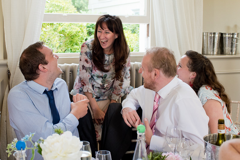 Guests laughing at Morden Hall wedding