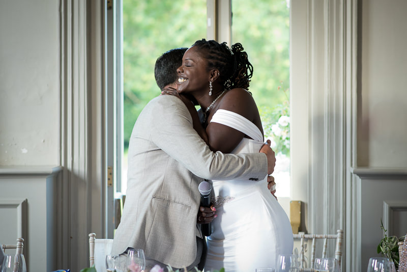 Bride and groom hug at Morden Hall
