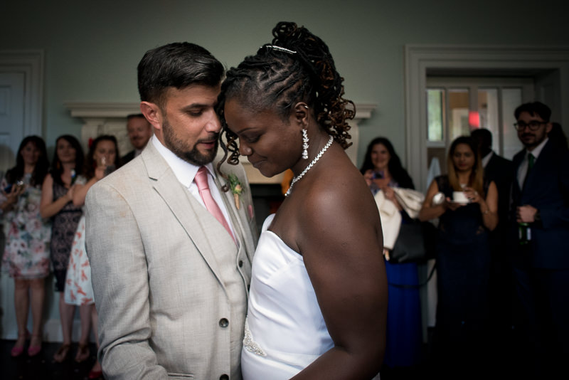 Black bride and white groom during first dance at Morden Hall
