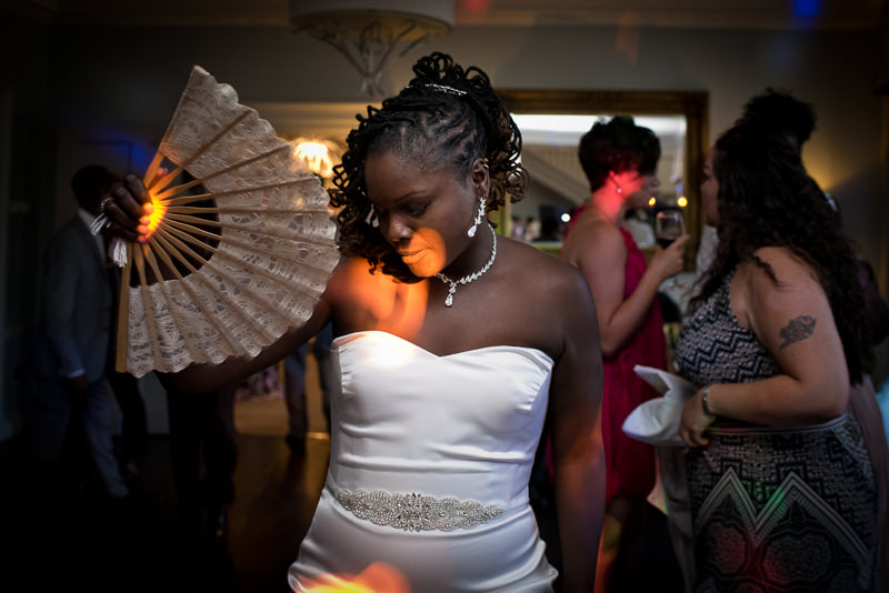 Black bride on dancefloor at Morden Hall