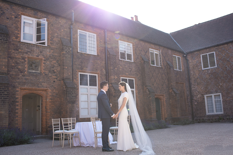 Bride and groom in courtyard at Fulham Palace