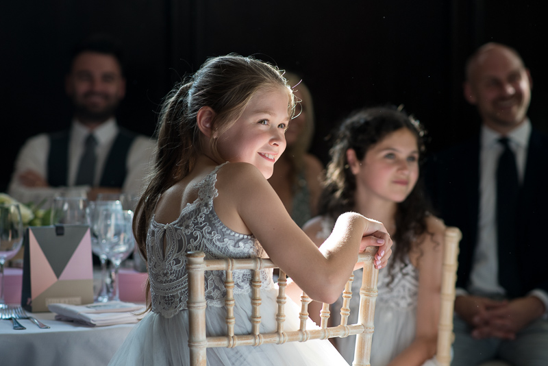 Flowergirl during speeches at Fulham Palace wedding