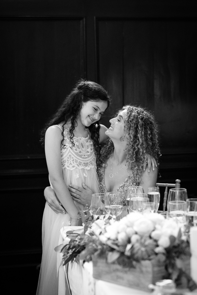 Bridesmaid and flower girl during Fulham Palace wedding reception